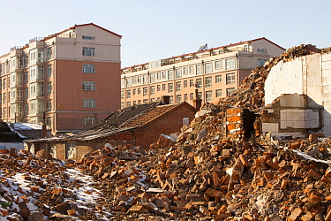 Demolition of house to make way for modern high rise apartment blocks, Suihua, Heilongjiang province, China, March 2009.