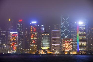 Office blocks lit up at night with Hong Kong, China. February 2010.