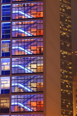 Office blocks lit up at night in Hong Kong, China. February 2010.