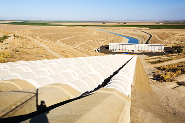 Pumping station sending water uphill over the mountains on the California aqueduct. This brings water from snowmelt in the Sierra Nevada mountains to farmland in the Central Valley. California, USA, S...