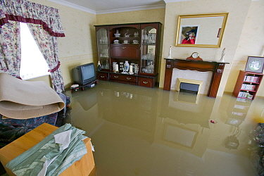 Interior view of house during flooding, Toll Bar near Doncaster, South Yorkshire, England, UK, July 2007.