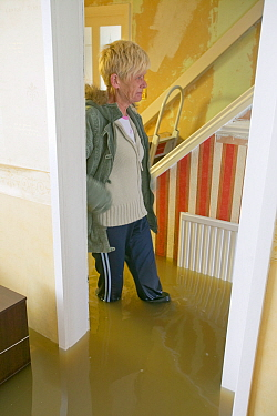 Resident inside flooded house, Toll Bar near Doncaster, South Yorkshire, England, UK, 28th July 2007.