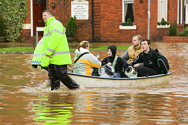 Emergency services helping people evacuate their homes, Carlisle, Cumbria, England, UK, 9th January 2005.