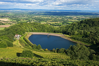 View from the Malvern Hills AONB of British Camp Reservoir, the Worcestershire Severn Plain and the Cotswolds from British Camp / Herefordshire Beacon, England, UK, August 2017.