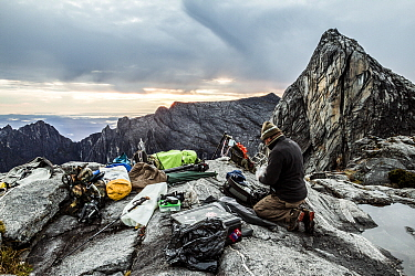 Cameraman Richard Kirby capturing timelapse near the summit of Mount Kinabalu, Borneo. May 2013.