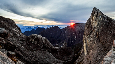 Sunrise as seen over Low's Gully and ugly sister peak, from the base of Low's peak (Approx 4000 metres) Mount Kinabalu. Borneo, May 2013.