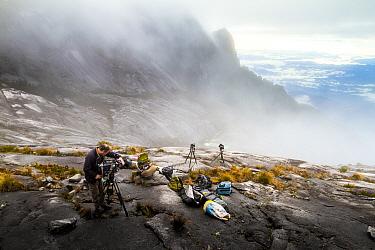 Camera operator Richard Kirby filming on the summit of Mount Kinabalu, Borneo, May 2013.