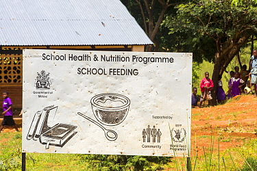 School feeding program sign at a school on the Zomba Plateau, in a country where malnutrition is common, this World Food Program provides additional food to infant school pupils is very important.