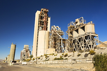 A cement works at Tehachapi Pass California, USA, Cement production is one of the most carbon hungry industries on the planet. September 2014.