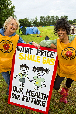Protestors with a protest banner against fracking at a farm site at Little Plumpton near Blackpool, Lancashire, UK, where the council for the first time in the UK, has granted planning permission for...