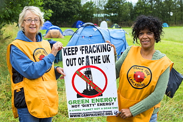 Women protestors with a protest banner against fracking at a farm site at Little Plumpton near Blackpool, Lancashire, UK, where the council for the first time in the UK, has granted planning permissio...