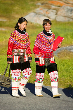 Inuit women wearing traditional Greenlandic national costume or Kalaallisuut, Ilulissat on Greenland. The costume consists of seal skin boots(Unnaat) bead necklaces (Nuilaqutit) and seal skin trousers...