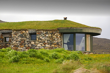 Modern green roofed house at Scarista on the isle of Harris, Outer Hebrides, Scotland, UK. June 2015.