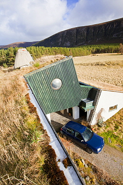 Environmentally friendly house that was built in the 1970's but still exceeds green build regulation today, at Feshiebridge, Cairngorm, Scotland, UK,  March 2012.