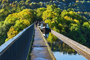 Canal barges crossing the Pont-Cysyllte aqueduct, heading north over the River Dee, near Trevor in the Vale of Llangollen, North Wales, UK September 2017.