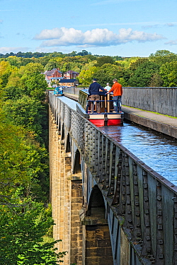 Canal barges crossing the Pont-Cysyllte aqueduct heading north over the River Dee near Trevor in the Vale of Llangollen North Wales UK September 2017
