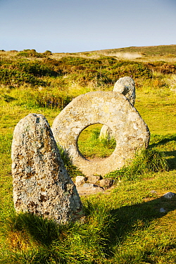 Men an Tol stone near St Just in Cornwall, UK. This late Neolithic monument is thuoght to have been part of a now disappeared stone circle or an entrance to an old burial chamber