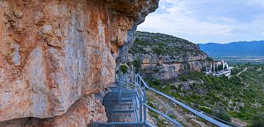 Metal staircase to Abrics de l'Ermita, hermit's caves, Ulldecona Village,  Catalonia, Spain, June.