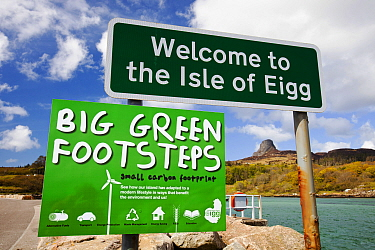 Big green Footsteps sign on Eigg Harbour, Scotland, UK. May 2012