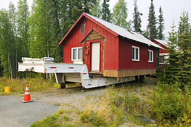 House in Fairbanks Alaska moved after it started collapsing into the ground due to global warming induced permafrost melt. August 2004