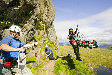 Injured climber with a dislocated shoulder is winched off Jacks Rake Pavey Ark by the Langdale Ambleside Mountain Rescue Team, Lake District, England, UK, August. August 2005