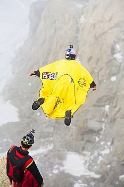 Base jumpers wearing wing suites jumping from the Aiguille Du midi above Chamonix, France. September 2014