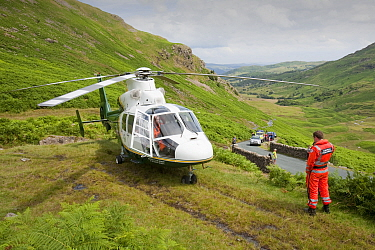 Paramedics from the Great north Air Ambulance and members of Langdale/Ambleside Mountain Rescue  evacuate an injured man who fell into Wrynose Beck. England, UK. July 2009