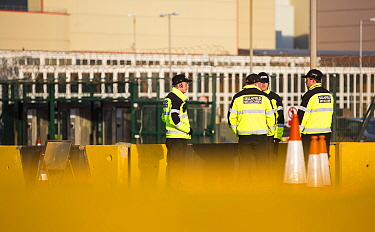 Security guards at one of the entrances to Sellafield nuclear power station near Seascale, West Cumbria, England, UK,  February 2013