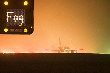 Aeroplane on the runway at East Midlands Airport in foggy conditions. December 2006