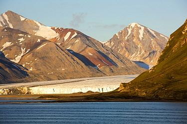 Glacier at Recherchefjorden on Western Svalbard with a mine supply ship. Svalbard, Norway. July 2013