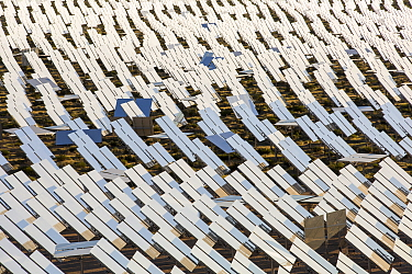 Heliostats reflecting sunlight onto solar tower at Ivanpah Solar Thermal Power Plant, the largest solar thermal plant in the world. It covers 4,000 acres of desert and produce 392 megawatts (MW) of el...