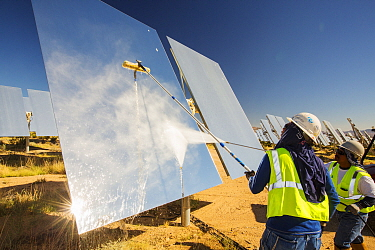 Workers washing the heliostats to maximise reflective power at the Ivanpah Solar Thermal Power Plant,  the largest solar thermal plant in the world. It covers 4,000 acres of desert and produce 392 meg...
