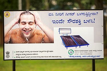 An advert for a solar water heater in  a park in Bangalore, India. December 2013