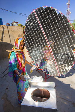 Women constructing solar cookers at the Barefoot College in Tilonia, Rajasthan, India. The Barefoot College is a worldwide charity, founded by Bunker Roy, its aims are, education, drinking water, elec...