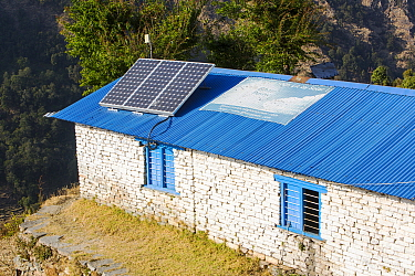 Solar photo voltaic panels on the rooftops of a school in Ladruk in the Himalayan foothills, Nepal. December 2012