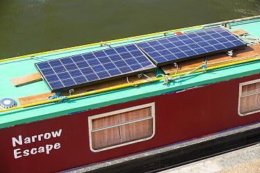 Solar panels on a canal boat behind Kings Cross, London, UK. June 2014