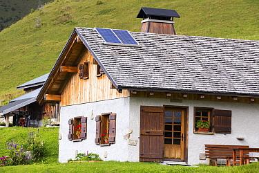 Solar panels on a visitor centre in the Vallon de la Lex Blanche below Mont Blanc, Alps, Italy. August 2014