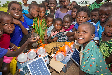 Children displaced by the January 2015 flooding with solar lights in Chiteskesa refugee camp after  near Mulanje. March 2015