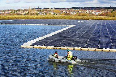 Floating solar farm being grid connected on Godley Reservoir in Hyde, Manchester, England, UK. February 2016