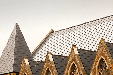 Solar tiles on St Silas's church in Pentonville, London, UK. This new solar roof, produces aprox. 47% of the buildings energy needs and will reduce C02 emissions by 7,000 kg per year. October 2010