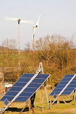 Solar panels and wind turbines on a farm near Woodhouse Eaves in Leicestershire, UK. March 2012