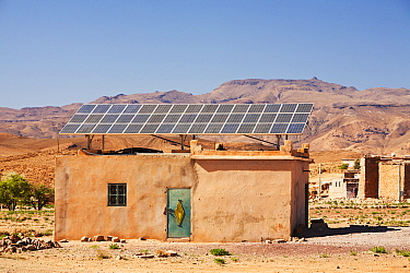 Solar panels on a house roof in a Berber village in the Anti Atlas mountains of Morocco, North Africa. April 2012