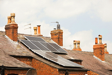 Solar panels on an old Victorian terrace house roof in Macclesfield, Cheshire, UK. May 2012