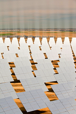 Heliostats, large reflective mirrors directing sunlight to the PS20 solar thermal tower, the only such working solar tower currently in the world. Sanlucar La Mayor, Andalucia, Spain. May 2011