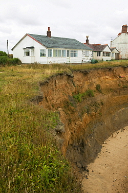 Happisburgh on the Norfolk Coast. This section of coast is the fastest eroding point in the UK and speeding up to to global warming induced sea level rise and increased stormy weather. August 2006