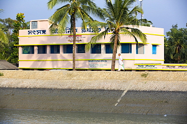 Coastal flood defences in the Sunderbans, a low lying area of the Ganges Delta in Eastern India, that is very vulnerable to sea level rise. The building behind the embankment is lower than the high ti...