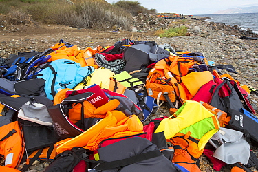 Life jackets and remains of boats left by Syrian migrants, refugees fleeing the war. Lesvos Island, Efthalou, Greece. September.