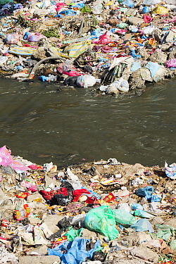 The Bishnumati river running through Kathmandu in Nepal. The river is full of litter and raw sewage which is emptied into the river. Nepal. December 2012