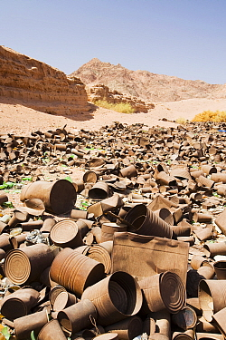 Tin cans discarded in the mountains of the Sinai desert near Dahab, Egypt. October 2008