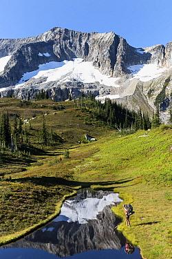 Vicky Spring next to a small tarn, Lyman Lakes Basin, Glacier Peak Wilderness, Wenatchee National Forest, Washington, USA, September 2014. Model released.